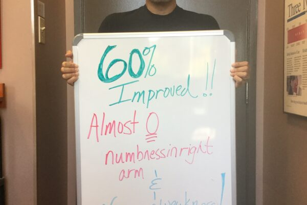Pictured here is patient Almeida Aires displaying his progress acheived through treatment!