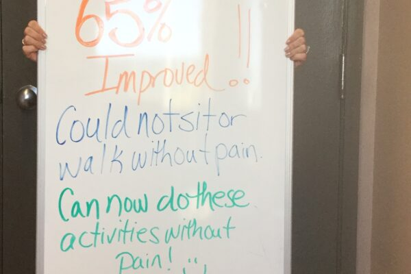 Pictured here is patient Jasmine Comfort displaying her progress acheived through treatment!