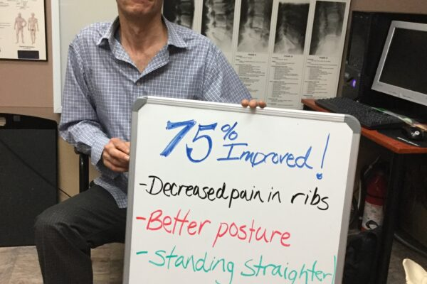 Pictured here is patient Guy Cousineau displaying his progress acheived through treatment!